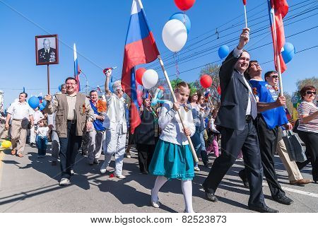 Tyumen, Russia - May 9. 2009: Parade of Victory Day in Tyumen. People and members of United Russia Party on parade poster
