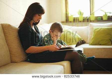 mother and son reading book