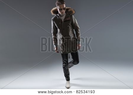 Fashionable young man posing