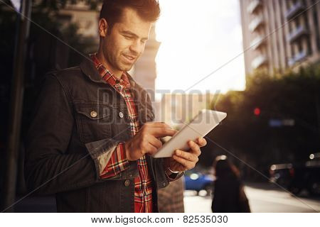 man using tablet on street in down town los angeles