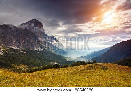 Great view of the foggy Tofane mountain range from Falzarego pass. National Park. Dolomites (Dolomiti), South Tyrol. Location Cortina d'Ampezzo. Italy, Europe. Dramatic scene. Beauty world.