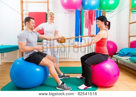 Patients at the physiotherapy doing physical exercises with therapist