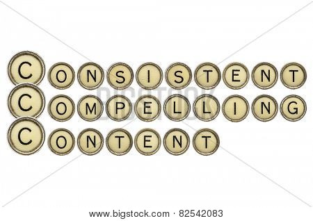 consistent, compelling content - word abstract  in old round typewriter keys isolated on white