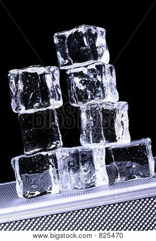 Ice cubes on freezer tray poster