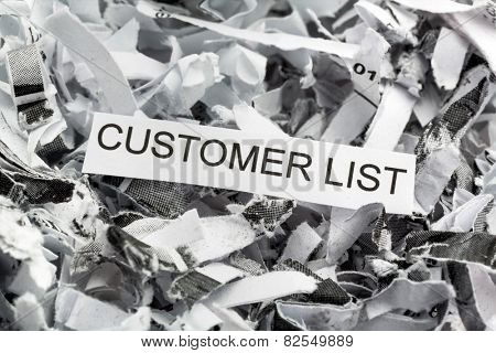 shredded paper tagged with customer list, symbolic photo for data destruction, data protection and customer data