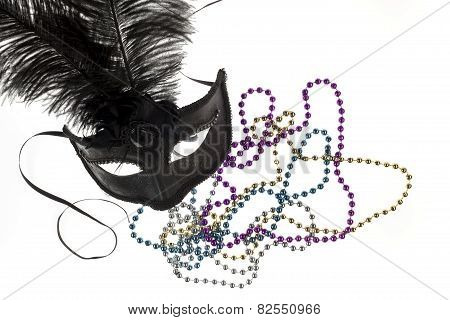 Shiny Gold, Purple, Blue And Silver Beads And Mardi Gras Mask With Feathers On A White Background. S