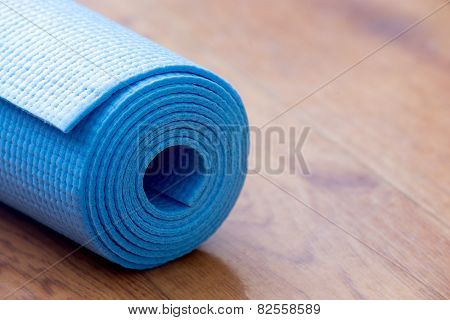 Rolled Blue Yoga Mat
