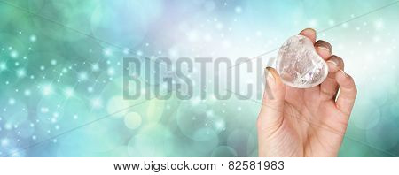Crystal healing banner with bokeh green background