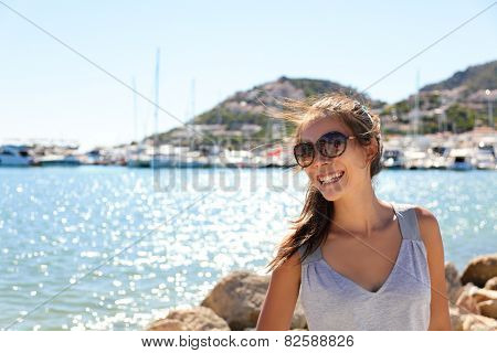 Leisure woman on holiday in yacht and sailboats marina resort town. Luxury lifestyle in famous port d'Andratx coastal town for the yachting and sailing community in Mediterranean Europe.