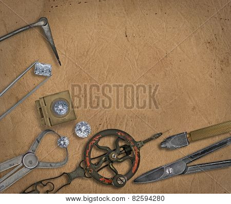 vintage jeweler tools and diamonds over  working bench, blank space for your text