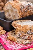 Fresh baked Walnut Bread (close-up shot) on wooden background poster