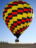 A hot air balloon coming in for a landing poster