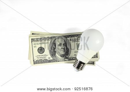Energy Saving - Money. Led Light Bulb On The Stack Of Dollars