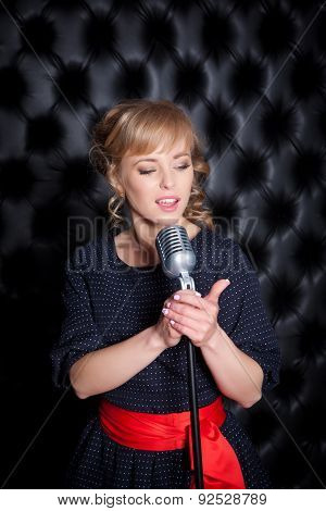 Beautiful Girl With A Microphone On Stage