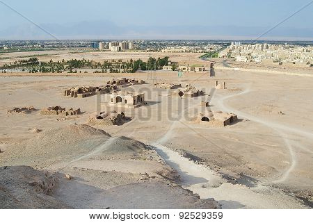 View to the Zoroastrian temples ruins and Yazd city from the Tower of Silence in Yazd, Iran.