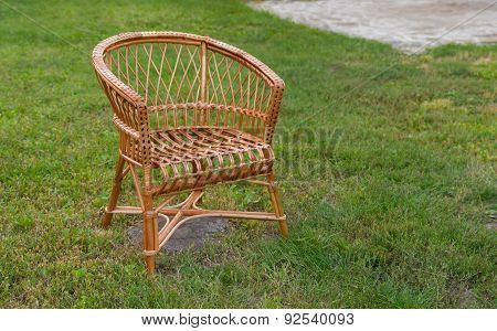 Empty wicker chair in