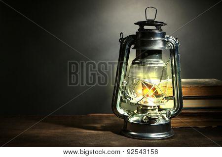 Kerosene lamp and letters on dark grey background