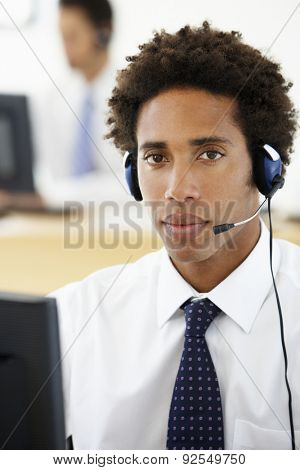 Service Agent Talking To Customer In Call Centre