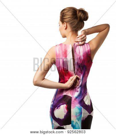 Woman unbuttons evening dress standing back