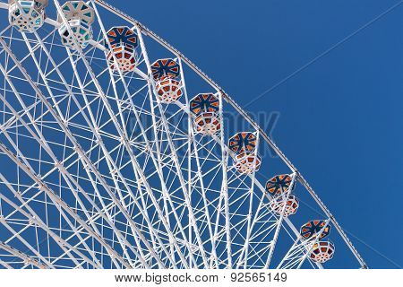 Ferris Wheel high architecture for leisure activity in amusement park poster