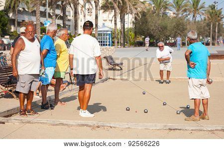 Seniors Spaniards Play Bocce On The Beach