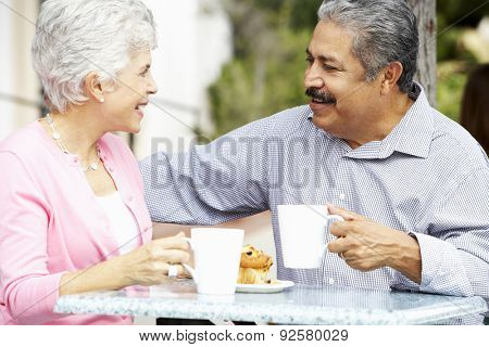 Senior Couple Enjoying Snack At Outdoor Caf\x81_
