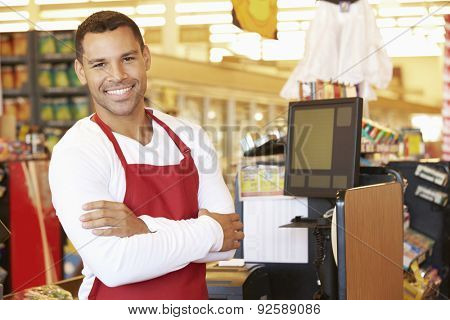 Male Cashier At Supermarket Checkout