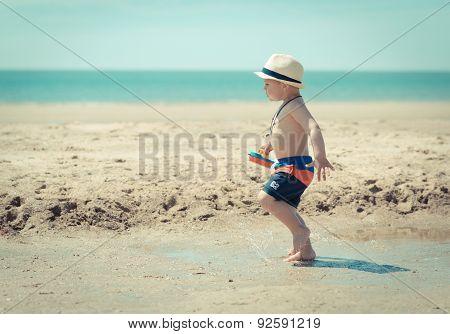 little boy child walking on the beach