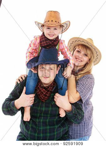 Mom dad and little daughter American cowboy costumes. My daughte