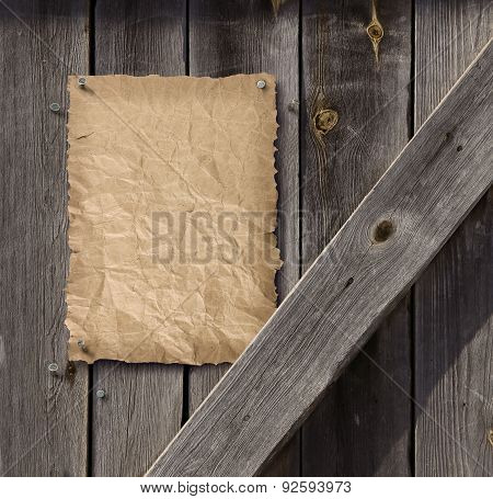 Empty Wanted Poster On Weathered Plank Wood Door