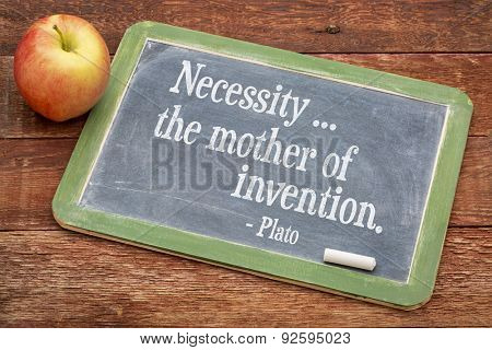 Necessity - the mother of invention  - Plato quote  on a slate blackboard against red barn wood