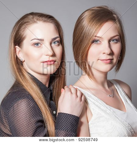 Two Beautiful Girlfriends Posing In The Studio