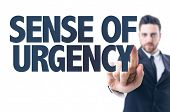 Business man pointing the text: Sense of Urgency poster