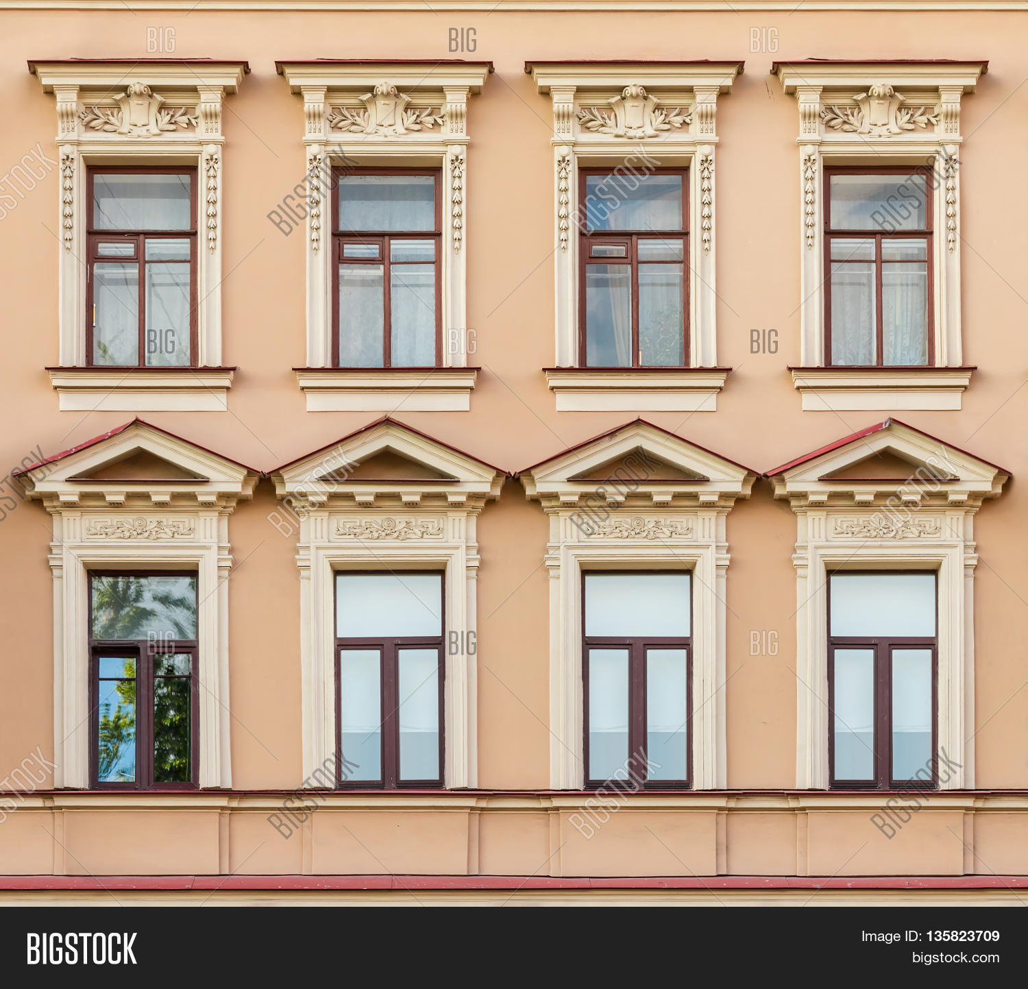 Several Windows In A Row On Facade Of Urban Apartment Building Front View  St. Petersburg