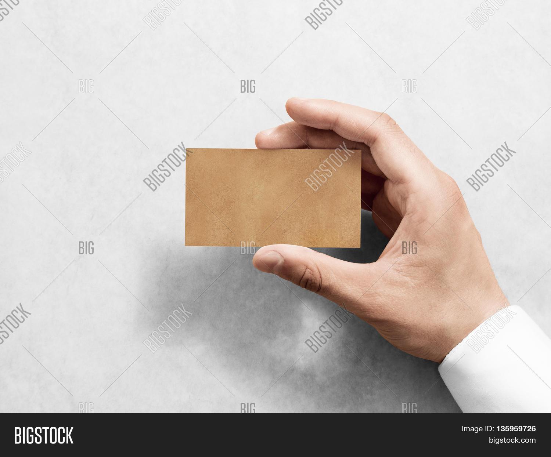 Hand hold blank plain kraft image photo bigstock for Craft paper card stock