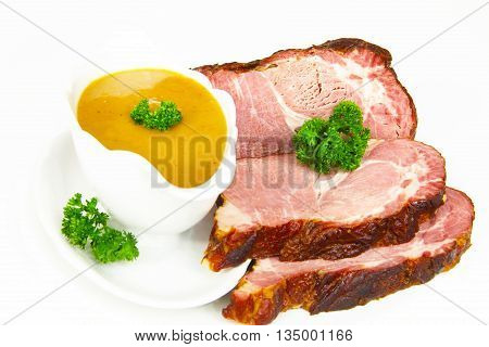 Smoked pork chop and sauce in gravy boat