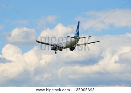 SAINT PETERSBURG, RUSSIA - MAY 17, 2016: Flying away in a cloudy sky airplane Boeing 737-800NG (VP-BEP) airline