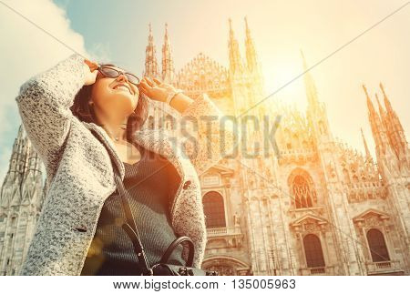 Woman in sun eye glasses stay near Doumo di Milano