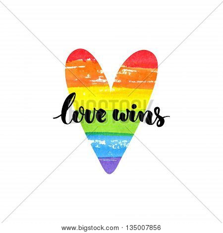 Love wins. Inspirational quote. Brush lettering on rainbow watercolor heart. Symbol of gay marriage, rights equality