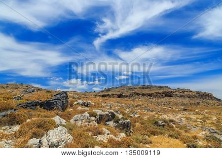 Mountain clouds igneous rock sunny day Greek