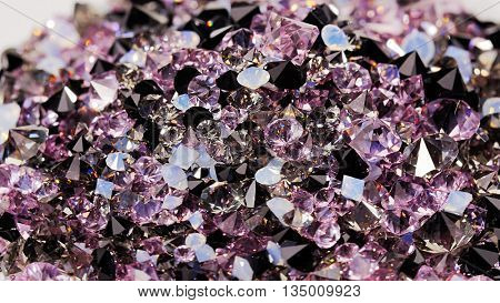 Many dark purple diamond jewel stones background, texture