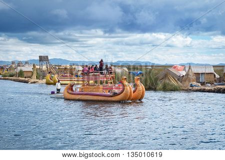 Traditional Village On Floating Islands On Lake Titicaca In Peru, South America
