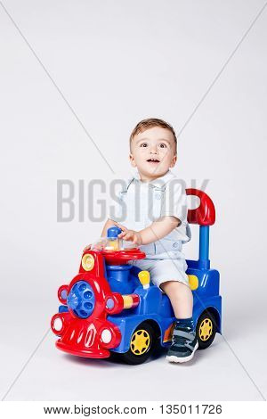 Baby Boy With A Toy Truck