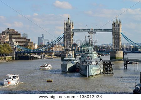LONDON - OCTOBER 03: London Tower Bridge and HMS Belfast on October 03 2014 in London UK. London is one of the world's leading tourism destinations
