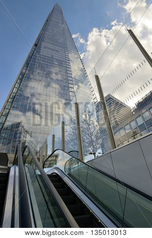 LONDON - OCTOBER 03: The glass Shard building at London bridge on October 03 2014 in London UK. Shard building is tallest building in europe at over 1000 feet (310 meters).