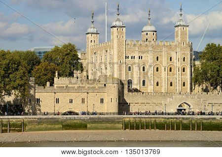LONDON - OCTOBER 03: The outside of the Tower of London on October 03, 2014 in London, UK. A famous tourist attraction over river Thames in the capital city London.