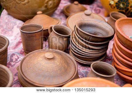 Ceramic ware handmade. Ware from clay at the fair. Glyanyanaya dishes handmade outdoors.