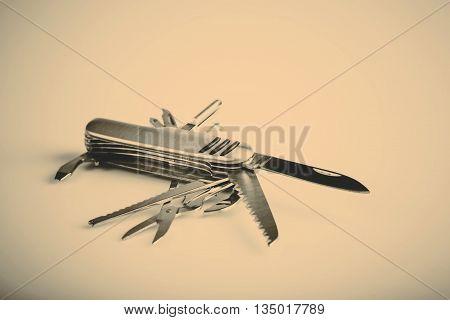 metallic swiss knife army keychain in retro