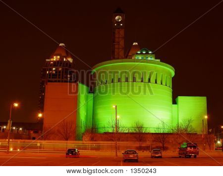 photo of a building iluminated with green light poster