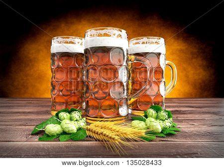 three glasses of oktoberfest beer with barley and hops on wooden desk - 3D render
